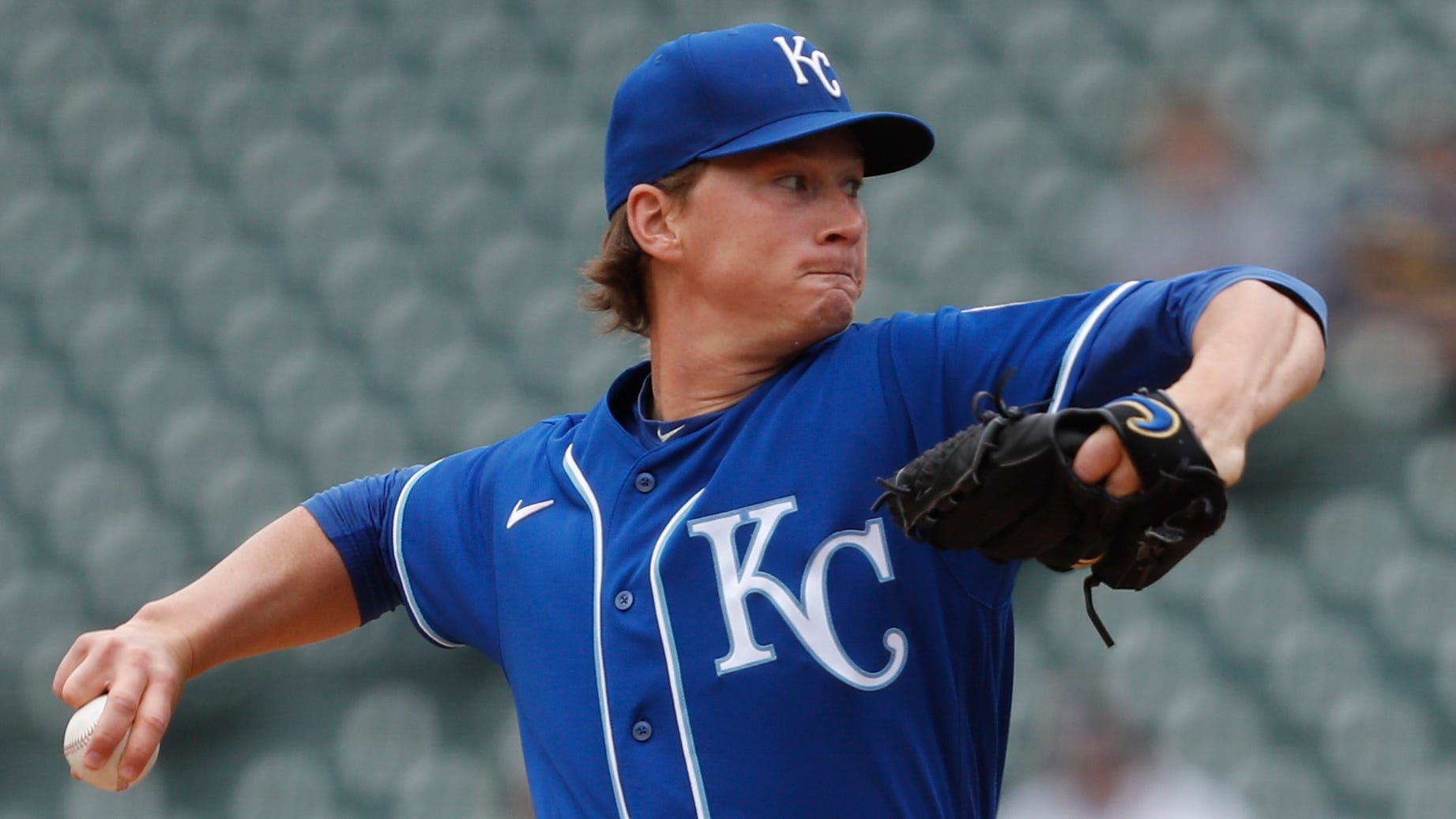 Kansas City Royals' Brady Singer pitches to a Tigers batter during the first inning.