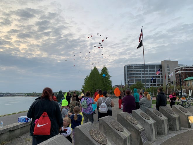 Family and friends gathered Friday evening to remember David Bonner, 18, who died this week. Attendees released lanterns and balloons with messages.
