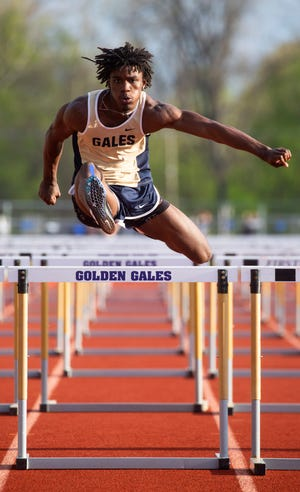 Lancaster's Nasir Robinson competes in the shuttle hurdles event during the Lancaster Fulton Relay event at Fulton Field in Lancaster, Ohio on April 23, 2021.