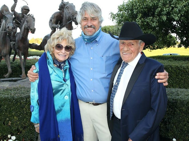 Marilyn, Steve and Keith Asmussen celebrate after Super Stock's victory in the Grade 1 Arkansas Derby on April 10 at Oaklawn Park in Hot Springs, Arkansas. (Photo courtesy of Coady Photography)