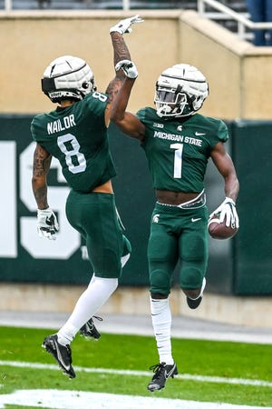 Is this finally the year that Michigan State's offense takes off? MSU's talented wideouts, including Jalen Nailor, left, and Jayden Reed, right, give the Spartans hope.