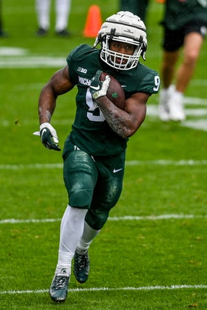 Michigan State's Kenneth Walker III runs for a gain during the spring football game on Saturday, April 24, 2021, at Spartan Stadium in East Lansing.