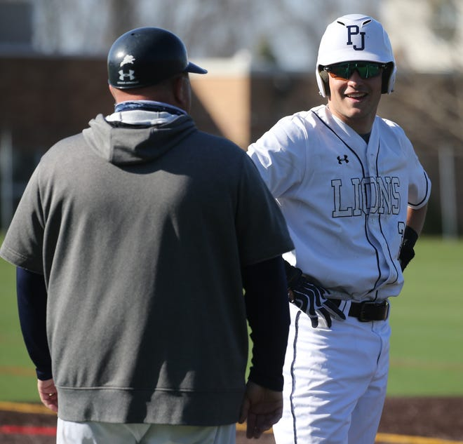 Coach Vincent Bello and his son Mike of Pope John talk while Mike is third base as Delbarton loses to Pope John 6-4 in high school baseball.