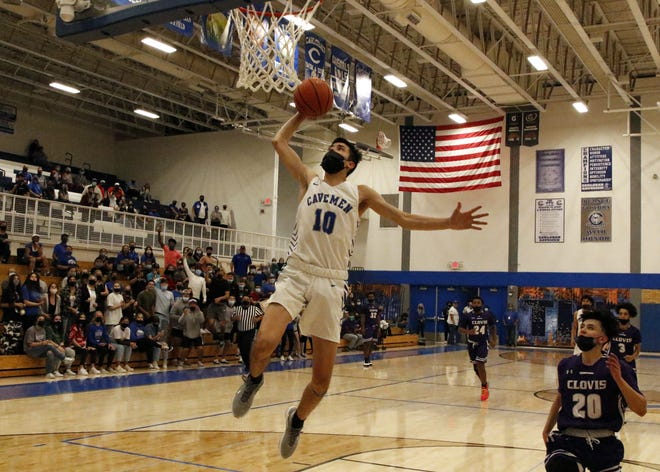 Carlsbad's Damien Perez throws down a fastbreak dunk in the final seconds of the 4-5A district game against the Clovis Wildcats on April 23, 2021. Carlsbad won, 46-37.