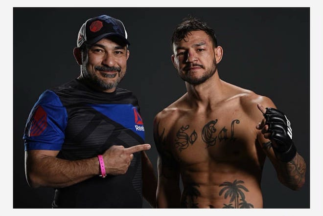 Cub Swanson (right) and Kami Safdari pose for a photo together following Swanson's fight against Artem Lobov on April 22, 2017.