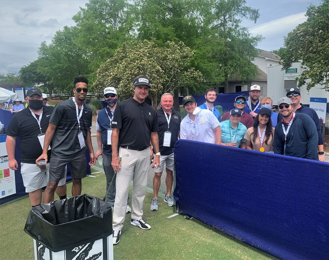 Bubba Watson with Blue Wahoos staff, guests on practice range during Friday's Zurich Classic of New Orleans.