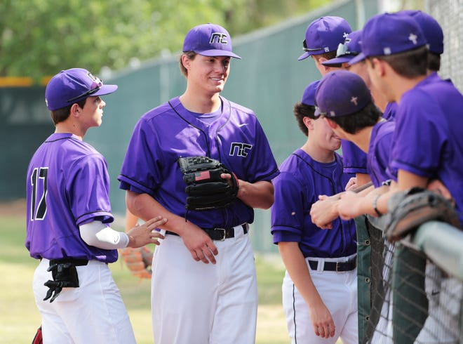 Northwest Christian pitcher Ty Howry (center) prepares for practice with his teammates in Phoenix April 14, 2021.