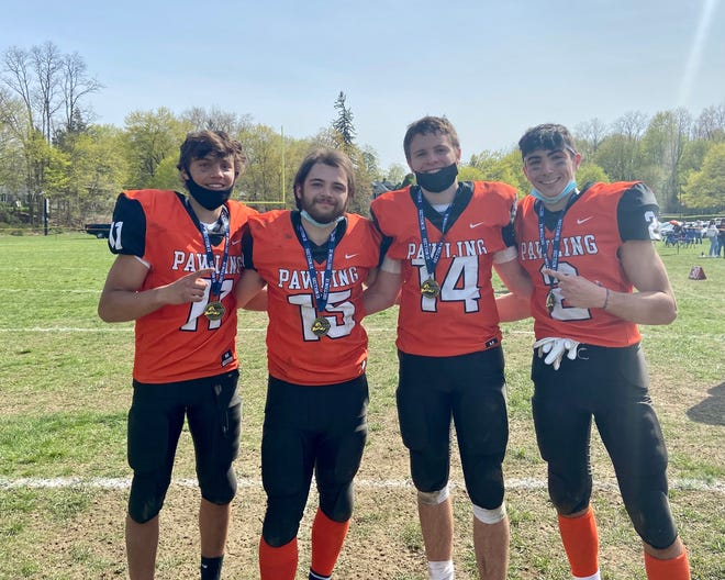 Pawling football teammates pose together with their medals after winning the 8-man football championship on Saturday. From left: Alex Reda, Joe Castellano, Will McCarthy and Aidan Clowry.