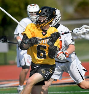 Red Lion's Mike Wilburn handles the ball against host Central York during lacrosse action Saturday, April 24, 2021. Bill Kalina photo