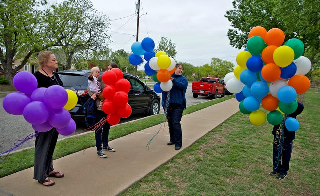 A group of advocates gather at city park for a balloon release in honor of National Crime Victims' Rights Week on Thursday, April 22, 2021.