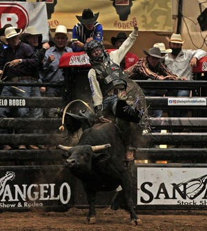Trey Benton III competes in the bull riding event at the San Angelo Rodeo on Friday, April 23, 2021.