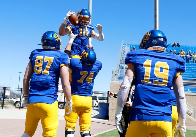South Dakota State Jackrabbits wide receiver Jaxon Janke #10 celebrates a touchdown with teammates against the Holy Cross Crusaders at Dana J Dykhouse Stadium on April 24, 2021 in Brookings, South Dakota.