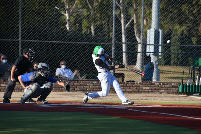 Thousand Oaks High's Dylan Jackson puts the bat on the ball during a game against Westlake earlier this season. Jackson is hitting .395 for the unbeaten Lancers.