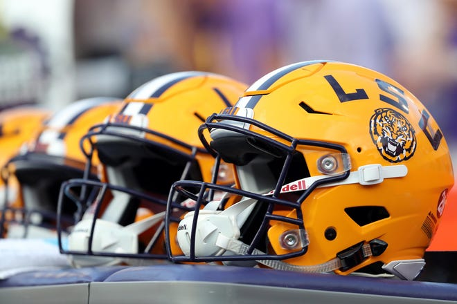 LSU football helmets on the sideline during a game against Florida.
