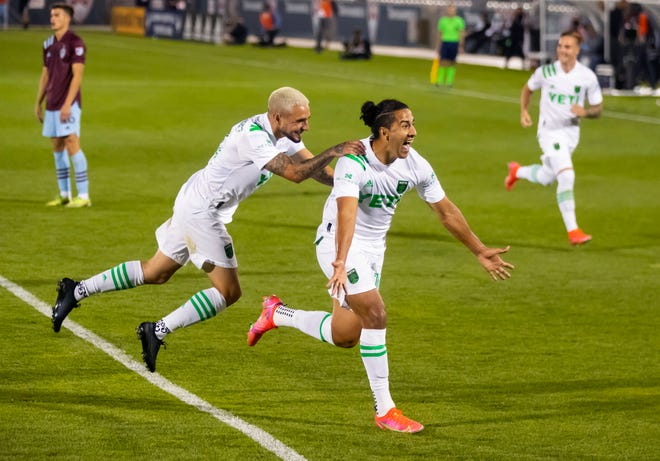 Apr 24, 2021; Commerce City, Colorado, USA; Austin FC midfielder Cecilio Dominguez (right) celebrates with teammate Diego Fagundez after scoring a goal against the Colorado Rapids in the second half during the home opener at Dick's Sporting Goods Park.