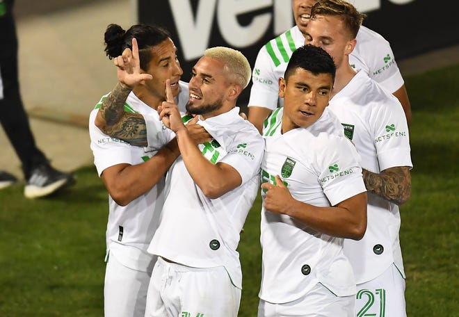 Apr 24, 2021; Commerce City, Colorado, USA; Austin FC forward Diego Fagundez (14) (center) celebrates his goal in the first half of the match against the Colorado Rapids. at Dick's Sporting Goods Park.
