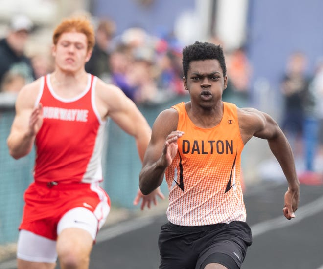 Dalton's Ozzie Miller cranks to a meet record time in the 100.