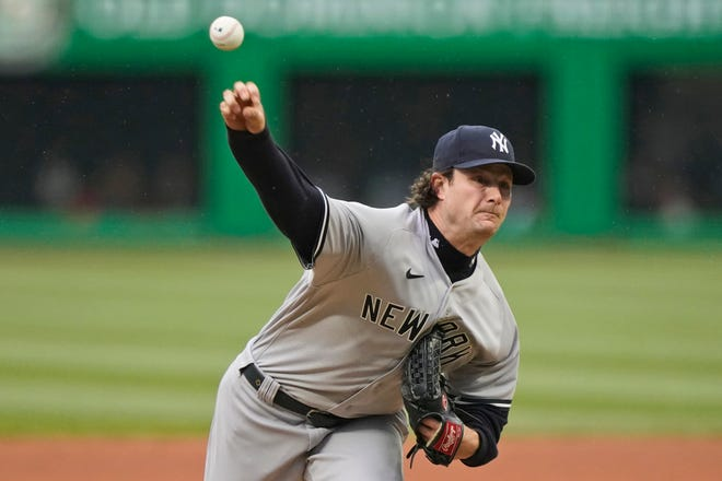 New York Yankees starter Gerrit Cole pitches in the first inning of the Yankees' 2-1 win over Cleveland at Progressive Field on Saturday night. [Tony Dejak/Associated Press]