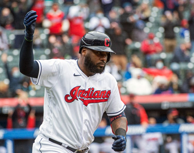 Cleveland's Franmil Reyes reacts after hitting a three-run home run off New York Yankees starting pitcher Jameson Taillon during the fourth inning of a baseball game in Cleveland, Sunday, April 25, 2021. (AP Photo/Phil Long)