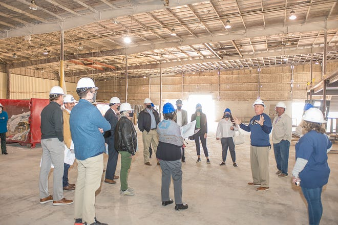 AmTech Principal Jay Barrett gives a tour of the academy's construction site to officials with the city of Amarillo, as well as the Amarillo Economic Development Corporation.