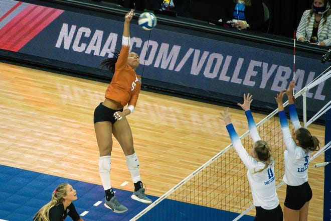 Outside hitter Skylar Fields attacks against Kentucky Wildcats middle blocker Elise Goetzinger (11) and libero Lauren Tharp (5) in April at CHI Health Center Arena and Convention Center. Fields led Texas with eight kills in a sweep of UTSA on Sunday.