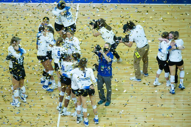 Kentucky players celebrate their four-set win over Texas in Saturday night's NCAA Volleyball Tournament championship match. It was the first national championship for softball in Kentucky history.