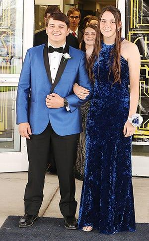 Grandon Kline escorts Holly Earl at the Mapleton High School prom Saturday evening. TONY ORENDER, TIMES-GAZETTE.COM