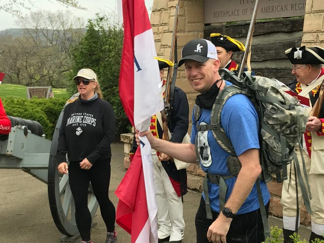 U.S. Army Sgt. Ben Linkous smiles after reaching the Fort Garrison historical site in Beaver, near the end of his 26.2-mile walk Saturday through Beaver County to raise support for families of fallen heroes.