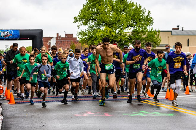 Racers take off after the firing of the starting gun for the 5k race on Saturday at the 12th annual ShamRock the 'Ville in downtown Bartlesville. Proceeds from the event go to Catholic Charities' Mary Martha Outreach.