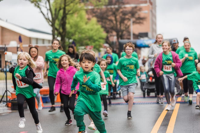 Families set off from the starting line as the 1-mile fun run begins Saturday for 12th annual ShamRock the 'Ville 5K and Fun Run in downtown Bartlesville.