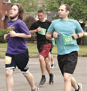 Zachary Pruett, left, and Adam Hardesty tackle the course during Saturday's Shamrock run.