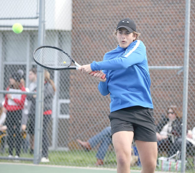 Boonville senior tennis player Gabe Greis hits a backhand while playing No. 1 doubles Thursday against Moberly at the high school tennis courts. The Boonville Pirates tennis team fell to Moberly 9-0.