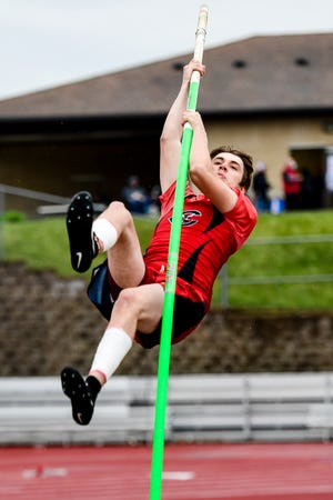 """Rudy Yutzy, senior on the 2021 Chillicothe High School track-and-field Hornets, holds tight to the pole for the ride up to the bar during the pole vault competition in last Friday's Mineral Water Classic meet at Excelsior Springs. Yutzy earned second place as one of only two entrants able to clear 9'11-3/4"""" (3.04 meters)."""