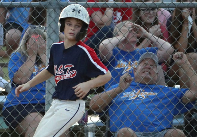 Parents react during a Little League game in Delaware in 2020.