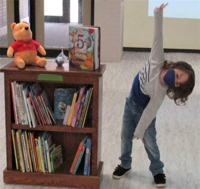 Leo Burgy can't contain his elation over receiving his bookcase full of books Sunday at the Ashland County-West Holmes Career Center.