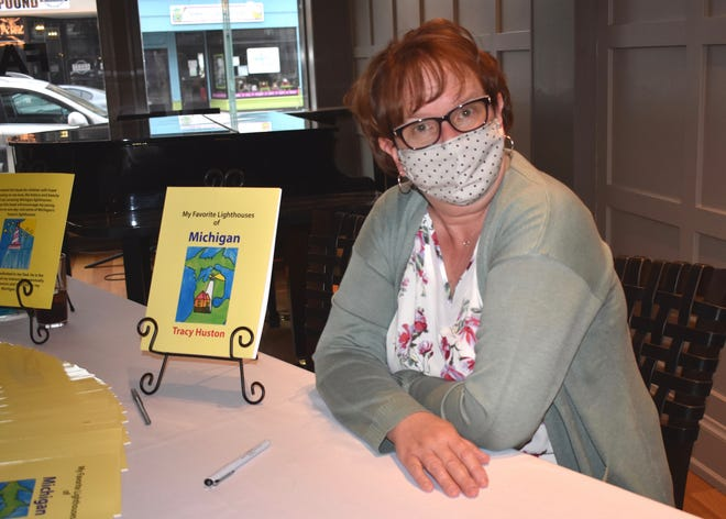 """Tracy Huston, a longtime Lenawee County resident, celebrated the publication of her first book April 15 with a book signing at Farver's Lounge inside the Croswell Opera House. """"My Favorite Lighthouses of Michigan"""" shares Huston's visits over the years to many of Michigan's historic lighthouses."""