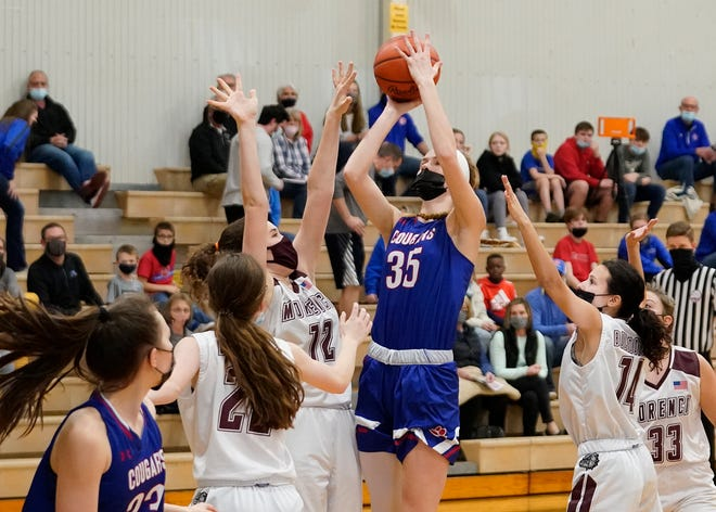 Lenawee Christian senior Bree Salenbien (35) shoots over Morenci's Josie Zuvers (12) during the Cougars' win in their Division 3 district semifinal contest on March 24 at Sand Creek. Salenbien has been named the Lenawee County Girls Basketball Player of the Year for the fourth-straight season.