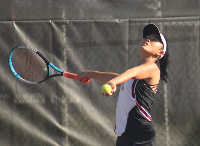 Episcopal's Izzy Blanton prepares to serve during an FHSAA high school district girls tennis match.