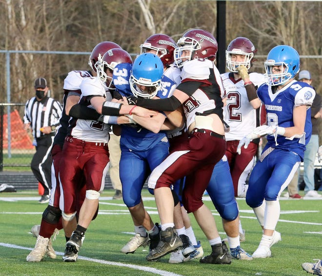 Narragansett senior running back Matt Corbiel (34) keeps the pile moving while fighting for extra yards during the Warriors' 24-0 Senior Day victory over the Quaboag Cougars, Saturday, April 24, 2021, at Watkins Field in Gardner.