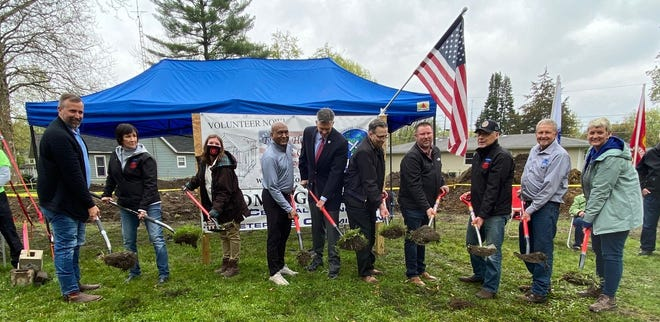 Officials break ground at a ceremony for the new homes that will be donated to veterans.