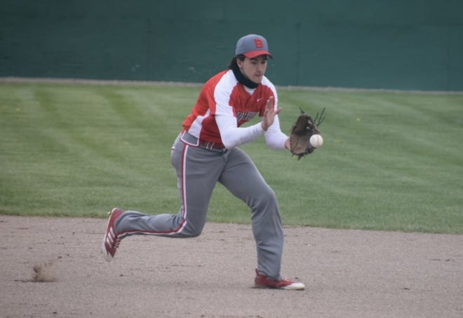Chace Cinglie fields a ball at shortstop for Bedford against Tecumseh Saturday.