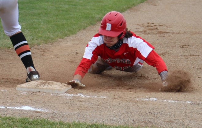 Bedford's Joey Nagle slides safely back into first base Saturday against Tecumseh.