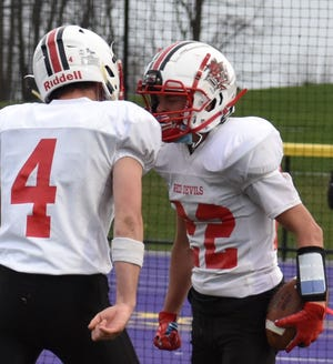 Vernon-Verona-Sherrill's Logan Vanderhoof (4) celebrates a touchdown catch by Bryce Palmer (22) during Saturday's game at Holland Patent. Palmer had two touchdown catches in the team's 35-6 win and finish the shortened season 5-0.