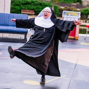 """Brenda Williams plays Sister Mary Regina in Lyric Theatre's production of """"Nunsense,"""" continuing through May 9 on the Myriad Gardens' Water Stage."""