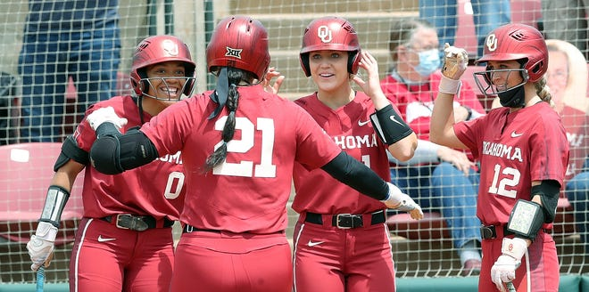 Grace Green, being greeted by Rylie Boone, Kinsey Koeltzow and Mackenzie Donihoo after a home run, is among the Batbuster alumni on OU's current roster. Green played for one of the Batbuster teams in Northern California.