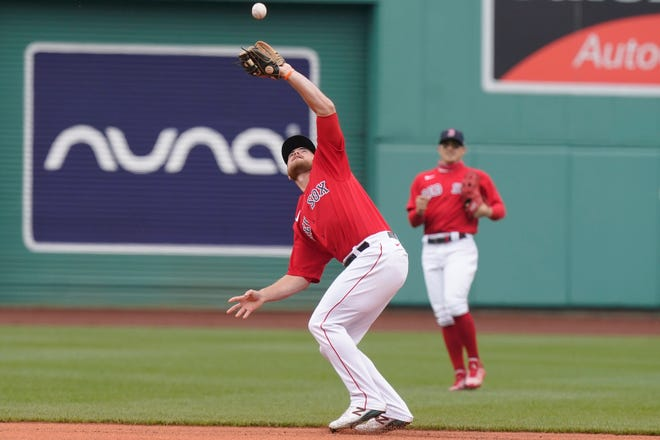 Red Sox second baseman Christian Arroyo catches a fly ball hit by the Mariners' Kyle Lewis in the first inning of Sunday's game, won by Boston, 5-3. Arroyo was supposed to get the day off but with Alex Verdugo sidelined by a sore hamstring, Arroyo was penciled into the lineup.