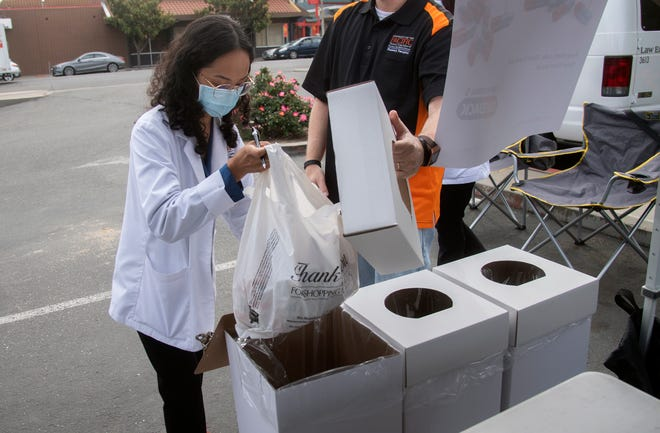 University of the Pacific pharmacy student Shaneisa Mae Nalias places prescription drugs into a bin as a part of a local observance of 20th annual National Prescription Drug Take Back Day at the Stockton Police Operations Building in downtown Stockton. The event was an opportunity to prevent pill abuse and theft by providing a place for the public to drop off old or unused and unwanted prescription drugs. In addition to the downtown Stockton location, three additional drop-off sites were available: Lincoln Center in Stockton, the Lathrop Senior Center and the Financial Services Parking lot in Lodi. The event was organized by the San Joaquin County of Public Health Services, San Joaquin County Opioid Safe Coalition, University of the Pacific's Thomas J. Long School of Pharmacy, Stockton, Lodi, Lathrop and Lodi police departments, the San Joaquin County Sheriff's Office and the U.S. Drug Enforcement Administration.