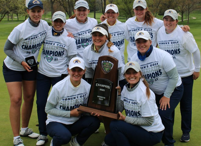 Members of the Kent State women's golf team pose with the trophy after capturing their 22nd consecutive MAC title on Saturday at Silver Lake County Club.