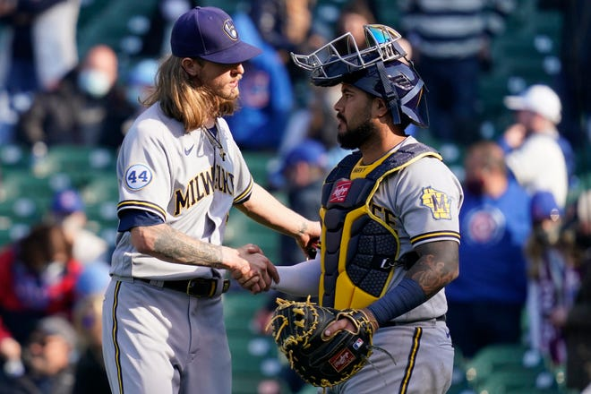Milwaukee Brewers relief pitcher Josh Hader, left, celebrates with catcher Omar Narvaez after they defeated the Chicago Cubs on Saturday, April 24, 2021, in Chicago.