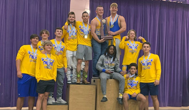 Members of the Charlotte High boys weightlifting team pose with the first-place trophy after finishing in a tie with Pace High at the FHSAA Class 2A State Championships on Saturday at Port St. Joe High.